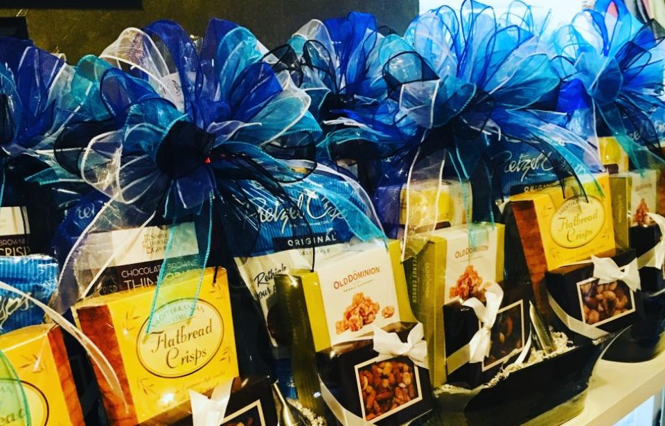 Customized Gift Baskets - Customized Corporate Gift Baskets that incorporate the clients branded colors and promotional items.