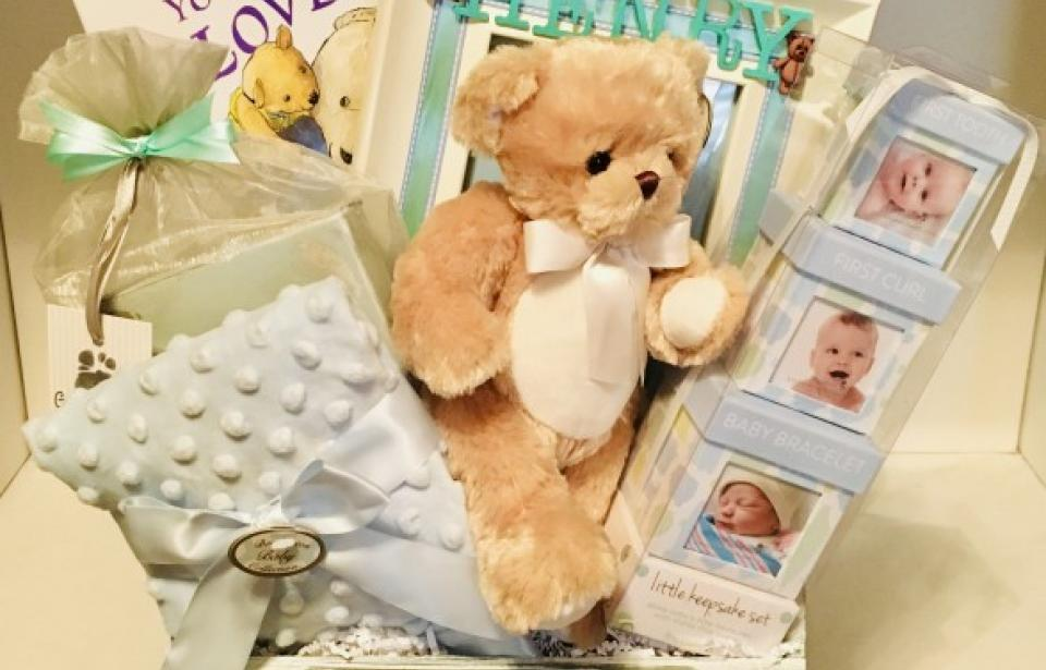 Custom Baby Gift Basket - We work with clients to customize and personalize gifts. This Baby Gift Basket was designed to match the theme of the nursery and keepsakes for the future. Babies first foot print set, keepsake boxes for babies 1st curl, tooth, and baby bracelet, and personalized photo frame.