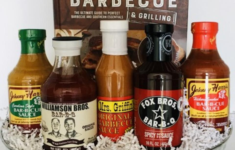 Georgia Barbecue Gift Basket - This Barbecue Gift Basket celebrates local small-batch gourmet barbecue sauces from Georgia and features a Southern Barbecue & Grilling Cookbook. A perfect gift for an executive, new homeowner, or barbecue guru.
