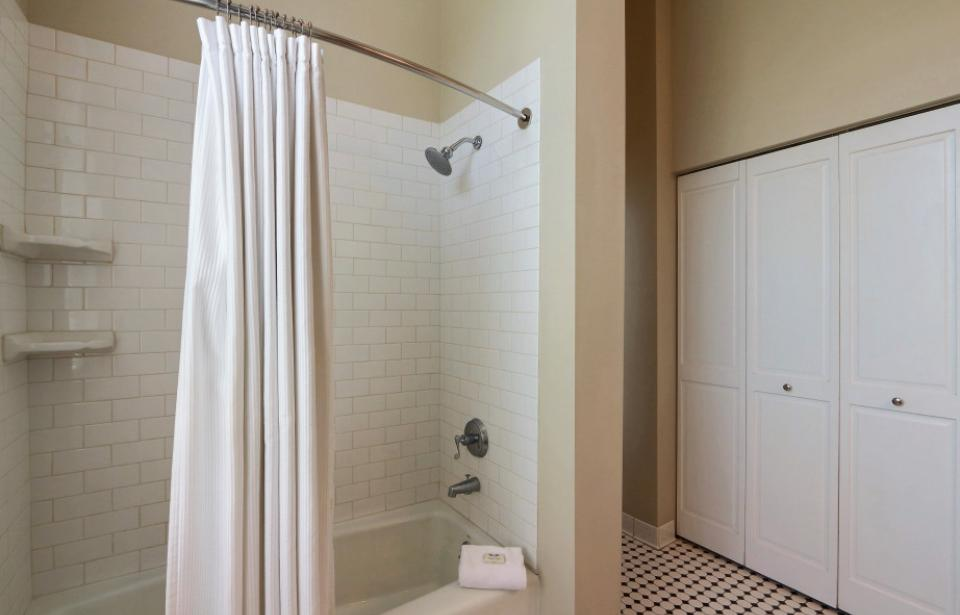 Bathroom Tub/ Shower - Shower, and closet space, with iron &ironing board, and hair dryer