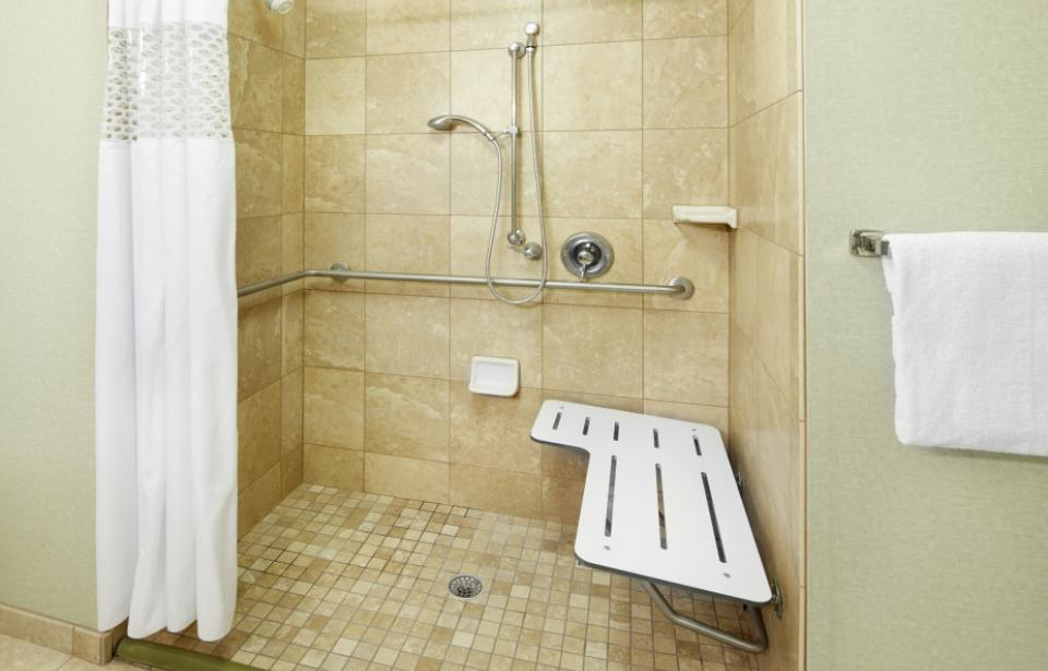 ADA Roll-In Shower - Our accessible rooms feature either a roll-in shower or accessible bathtub.