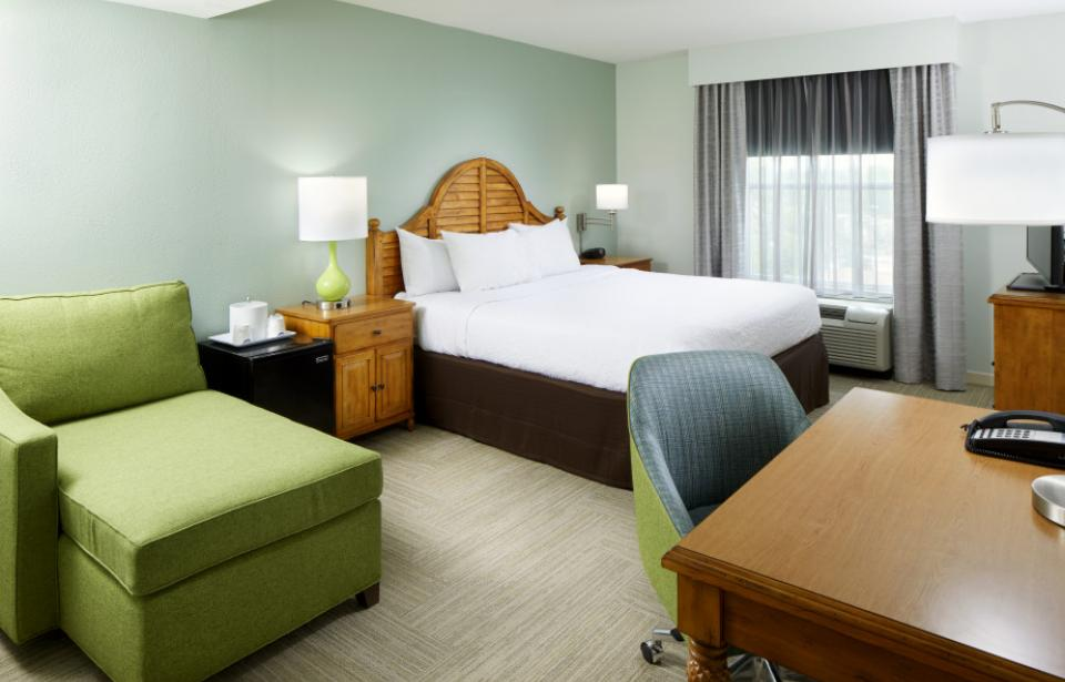 King Guest Room - Unwind in this king guest room which features our king-sized Clean and Fresh Hampton bed®, a comfortable easy chair with ottoman, and a 37-inch flat-screen TV. Catch up on work at the large desk, or surf the web with free WiFi access..