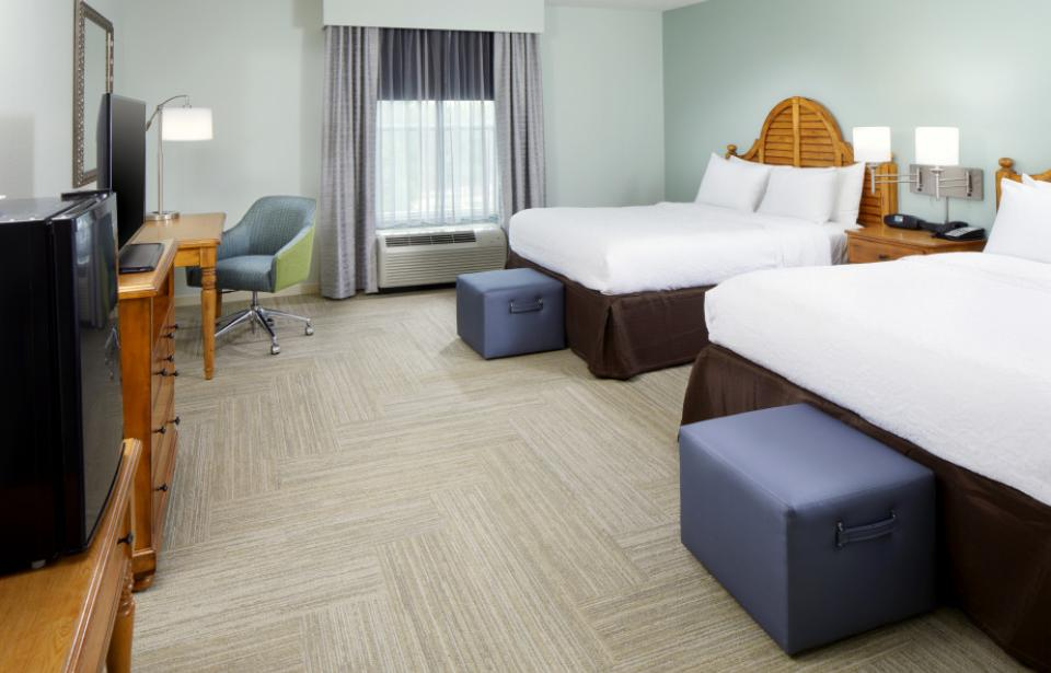Double Queen Guest Room - Unwind in this double queen guest room which features 2 of our queen-sized Clean and Fresh Hampton beds®, and a 37-inch flat-screen TV. Catch up on work at the large desk, or surf the web with free WiFi access.