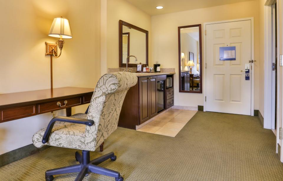 Studio Suite - Desk and wet bar area in our spacious studio suites.
