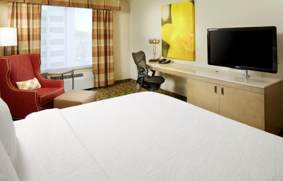 King Guest Room - Our modern king guest room offers plenty of work space, microwave, refrigerator, Keurig® coffee brewer, complimentary WiFi, and a 40-inch HDTV. Retire for the night in our king Serta Perfect Sleeper bed™.