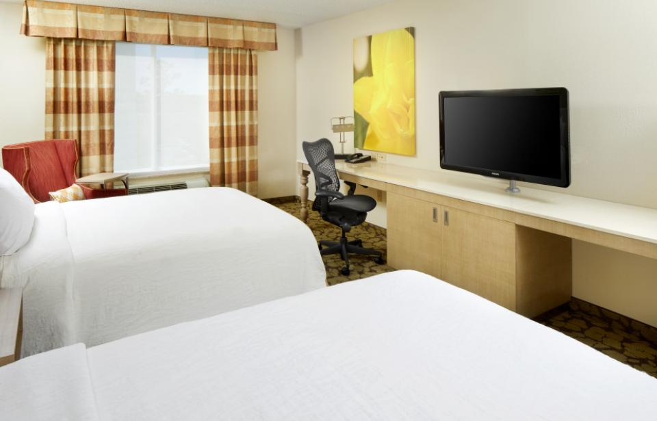 Double Queen Guest Room - Our modern double queen guest room offers plenty of work space, microwave, refrigerator, Keurig® coffee brewer, complimentary WiFi, and a 40-inch HDTV. Retire for the night in our queen Serta Perfect Sleeper beds™.