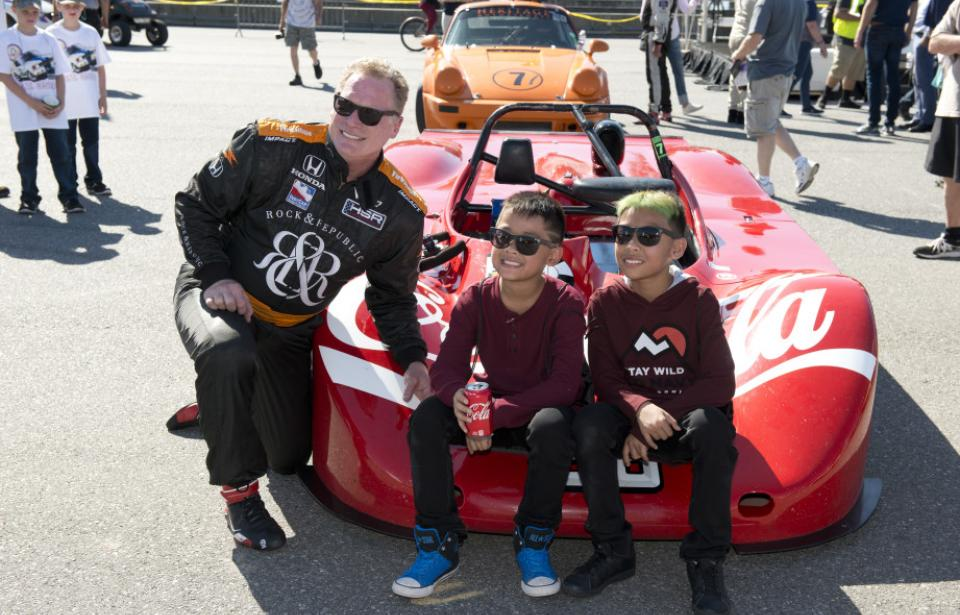 Fun for the whole Family - Kids and drivers pose in front of the Coca-Cola race car. Up close & personal!