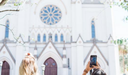 Visitors snap photos of the Cathedral of St. John the Baptist