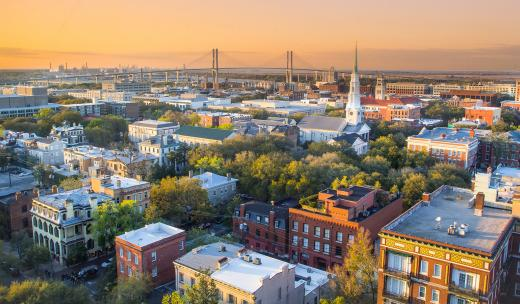 A view of Savannah's Historic District and the Talmadge Bridge at sunset.