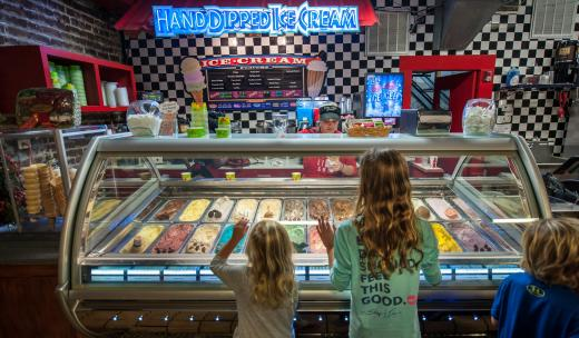 Kids looking at ice cream at River Street Sweets in Savannah, Georgia.