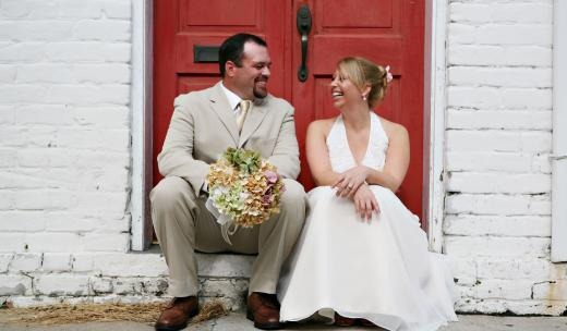 A couple sits in a doorway in Savannah, Georgia.